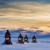 Snowmobiling in the polar night. Photo: Ørjan Bertelsen.