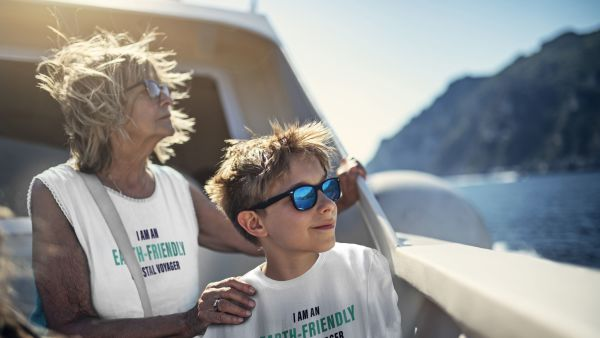 Grandma and grandchildren with earth-friendly coastal voyager t-shirts. Getty/Havila.