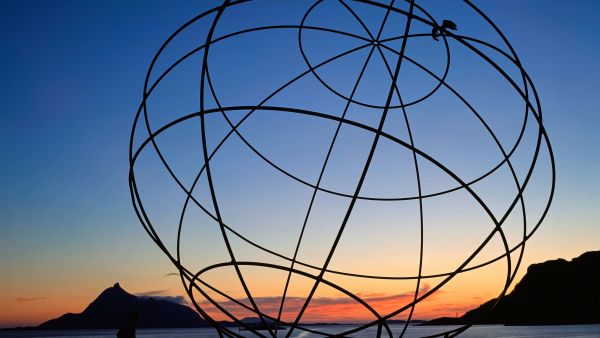 The Arctic Circle sculpture at North Cape in Sunset.