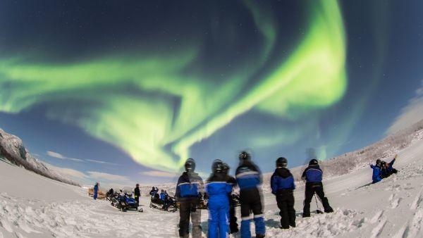 Snowmobiling under the northern lights, photo: Nicolas Vera-Ortiz