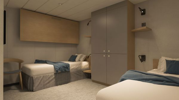 Cabin with two single beds and two pullman beds in inside cabin.