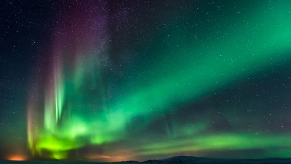 Northern lights - aurora borealis in purple, pink and green