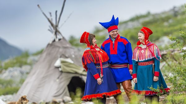 Sami family outside their tent, the lavvo. Photo: Ørjan Bertelsen, Arctic Coast