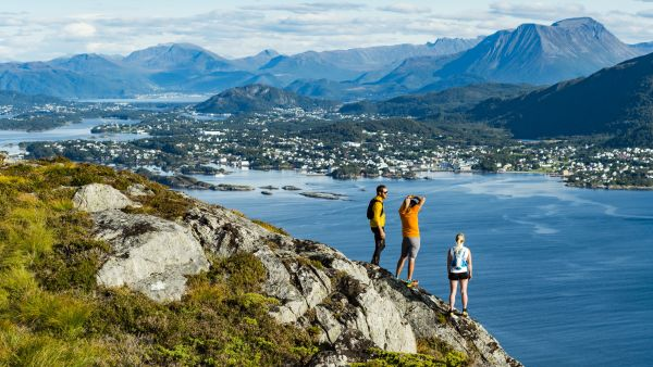People enjoying the view from the mountain Sukkertoppen in Ålesund