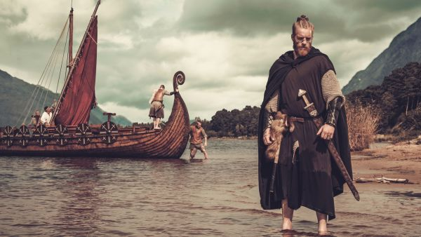 Viking and viking ship near Drakkar.
