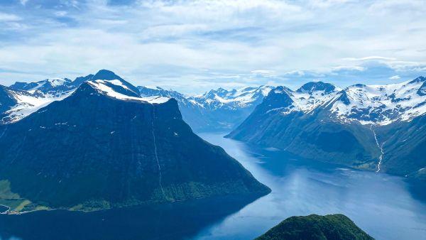 Hjørundfjorden in colours of blue seen from the mountain Saksa, Urke.