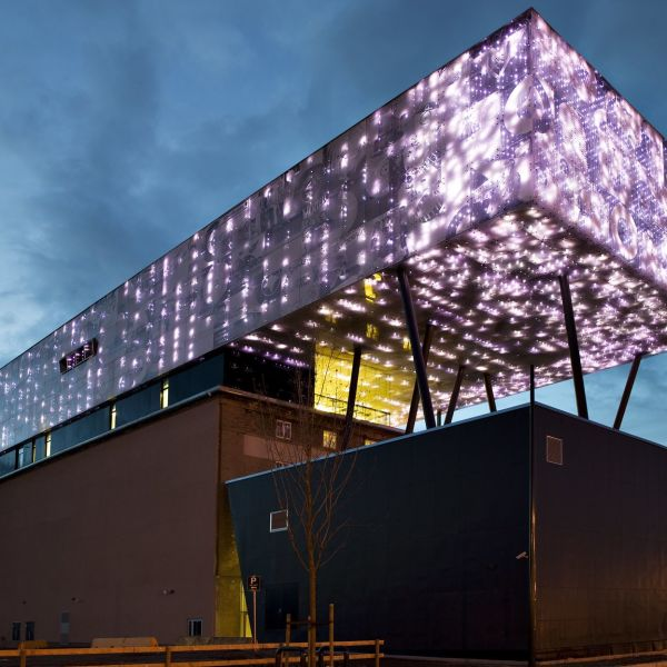 Rockheim museum with purple lightning at night.