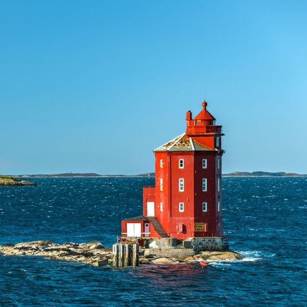 Red lighthouse on an islet in Norway