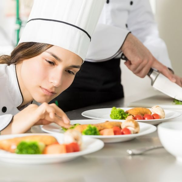 Young chef working on food.