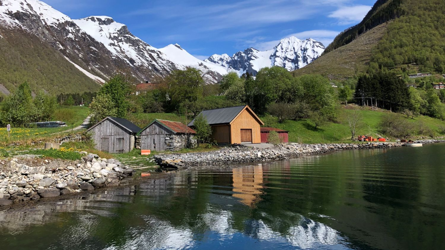 Boathouses by the fjord in the little hamlet Urke