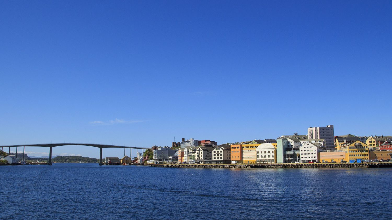 Kristiansund with blue sky and bridge connected to the city centre.