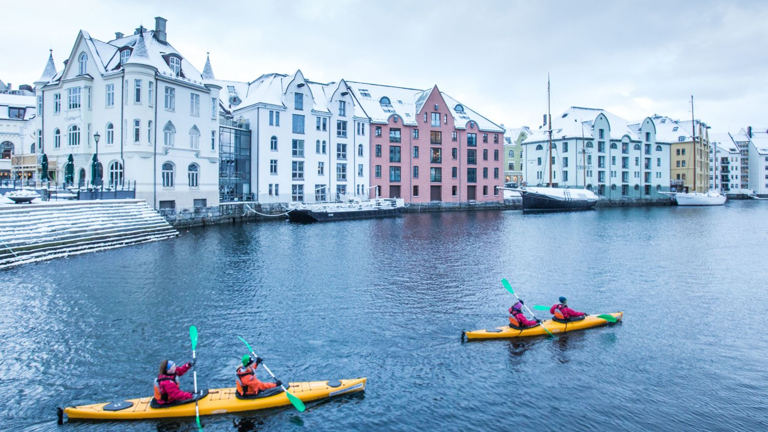 Kayaking in Brosundet in Ålesund in the winter.