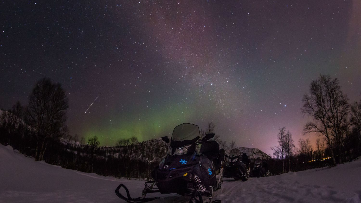 Snowmobiling in the winter night, photo: Nicolas Vera-Ortiz