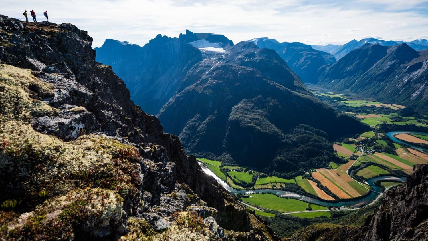 Hiking with a magnificent view to the Romdalen valley. Photo: Mattias Fredriksson, visitnorway.com