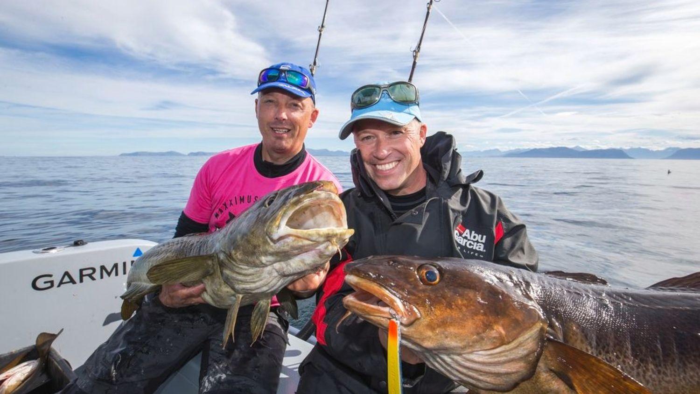 Happy people at sea fishing big cods