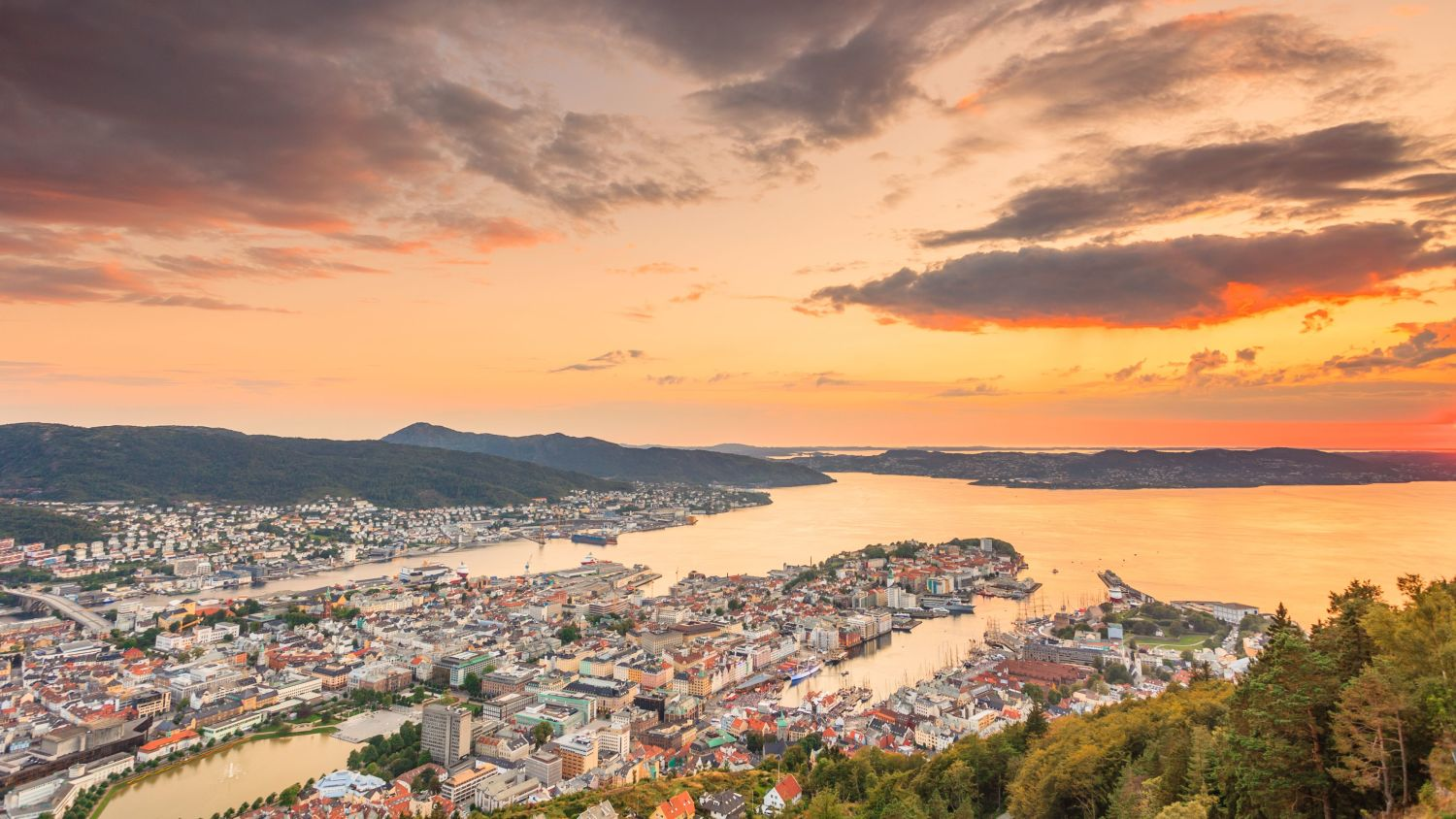 Sunset with orange and purple colours over Bergen in late summer.