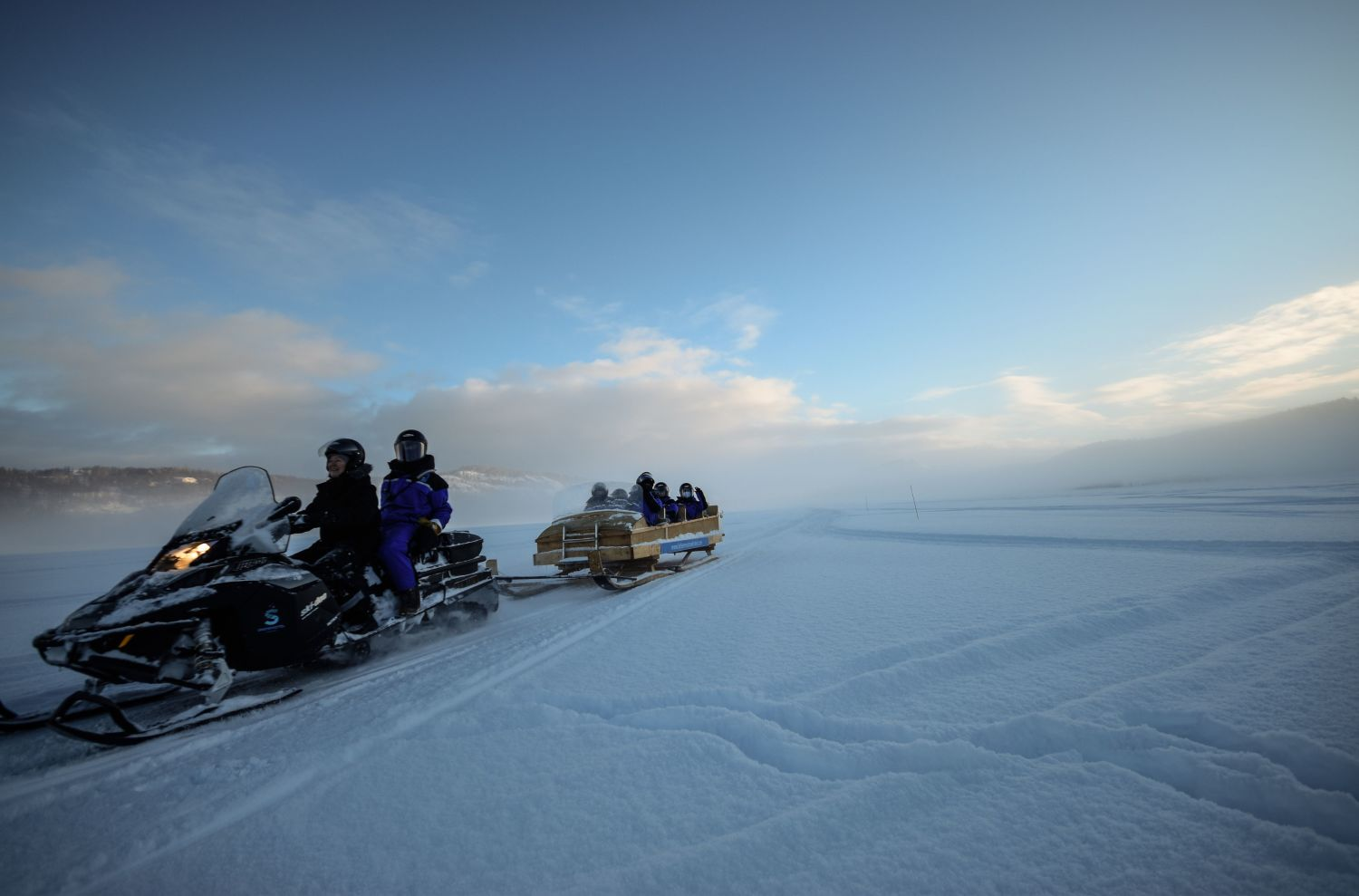 Snowmobiling a winter day in Kirkenes.
