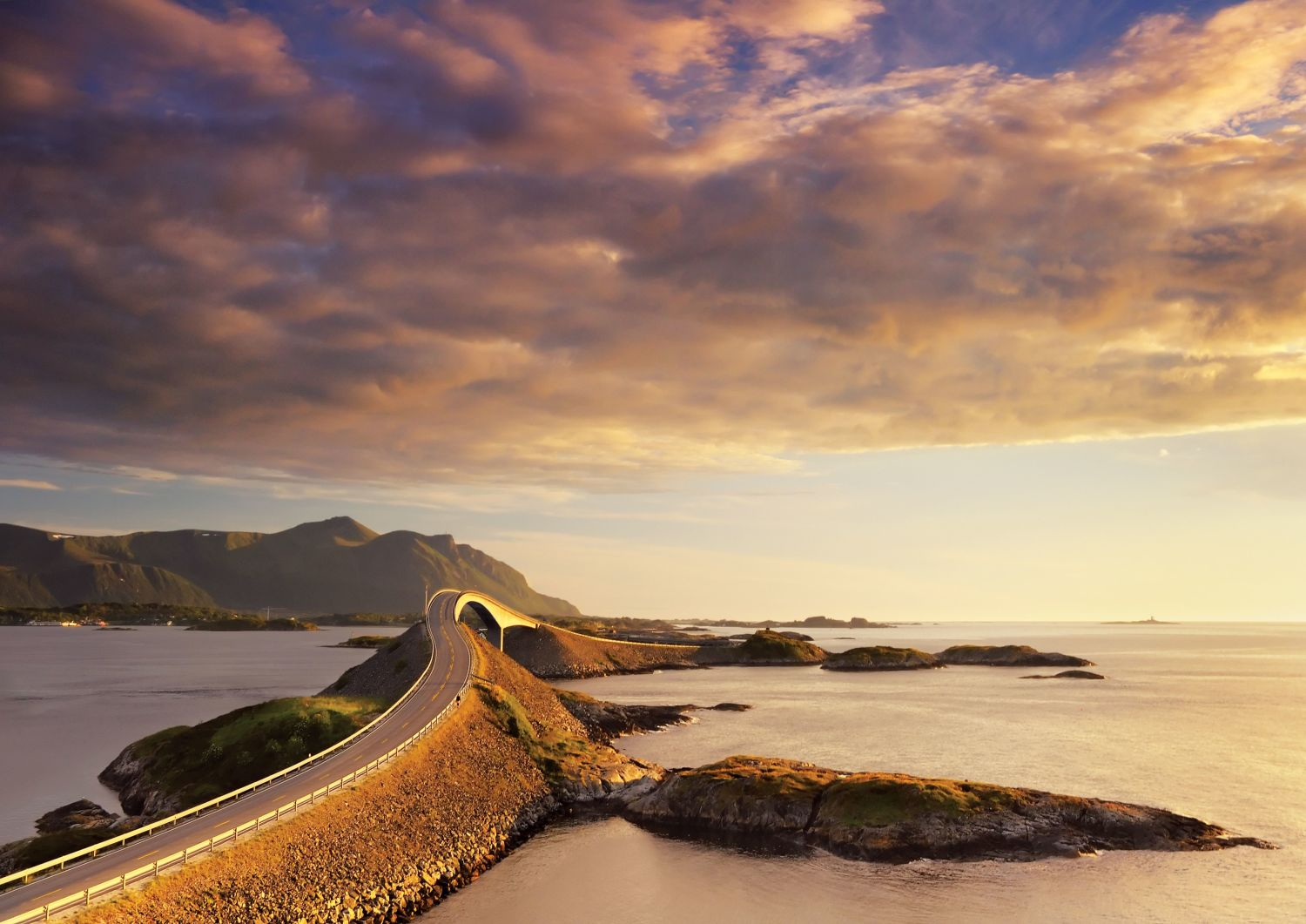 The Atlantic Road, beautifully coloured by the sunset. Photo: Jacek rózycki, visitnorway.com