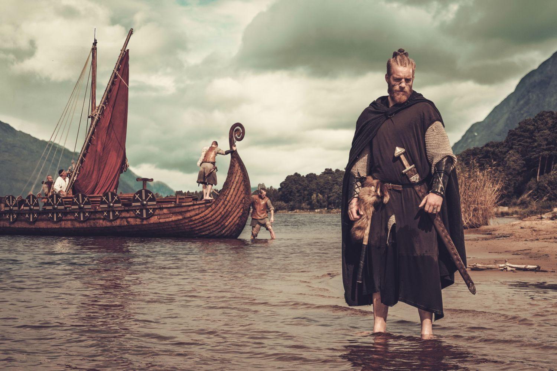 Viking and viking ship near Drakkar.