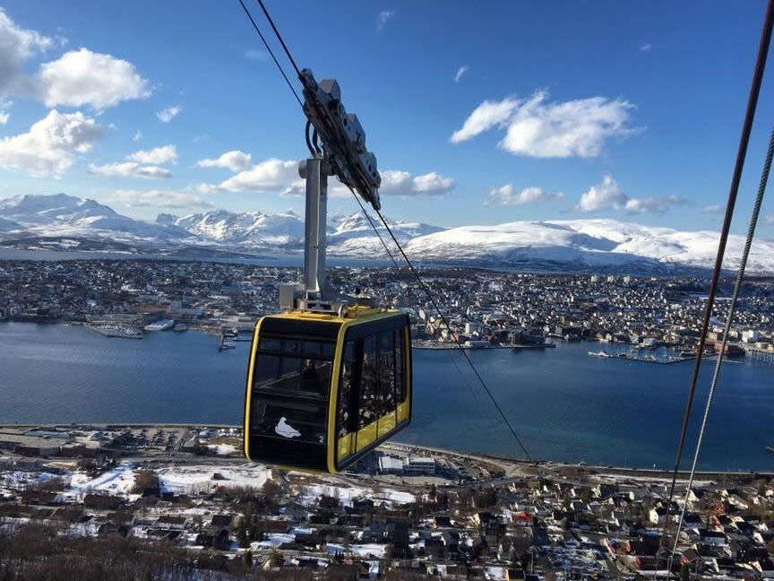 Yellow cable car in Tromsø, to viewpoint over the city.