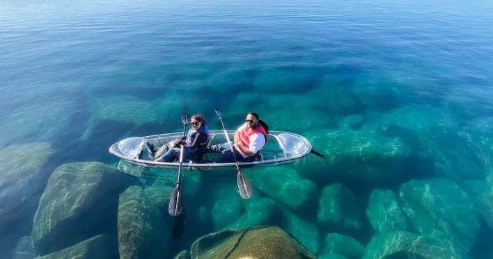 Canoe made of glass which makes you see right through the sea.