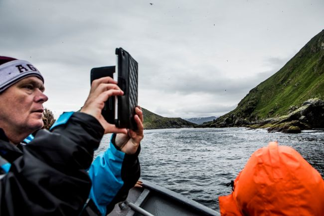 Birdwatching at Gjesvær from boat. Photo: Christian Roth Christensen, visitnorway.com