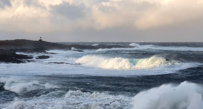 Big waves and a small lighthouse