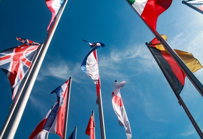 Flags from different nations. Photo: Unsplash