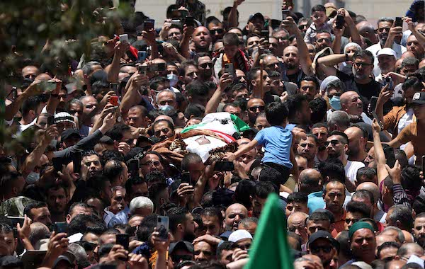 Thousands of Palestinian mourners attend funeral of Fatah party critic assassinated by PA officers in a home raid