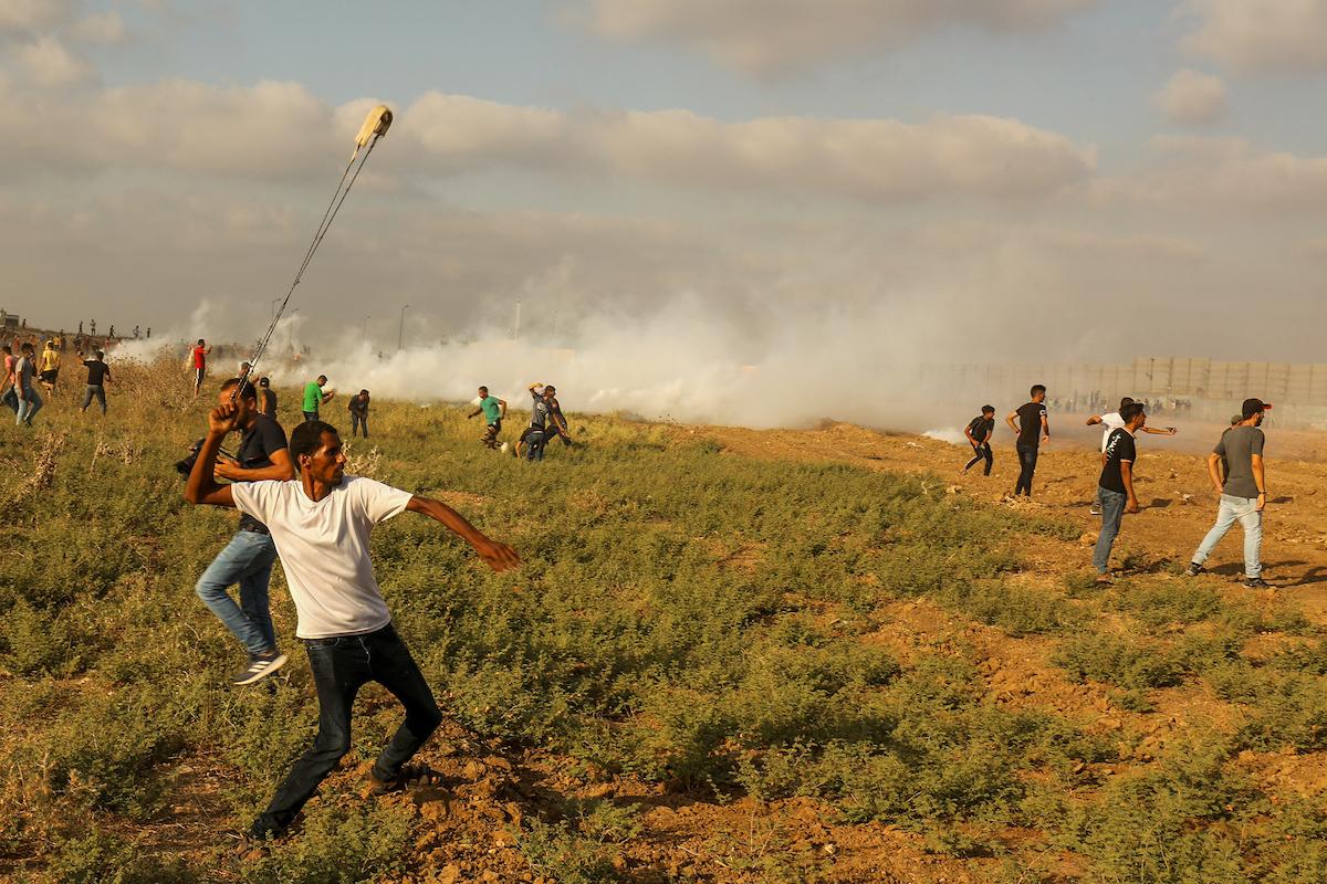 Gazans, Israeli soldier injured in massive border demonstration