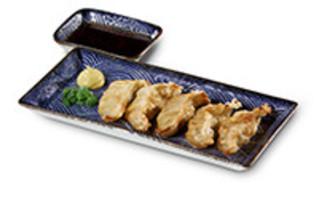 Gyoza Vorspeise 5 gedämpfte Teigtaschen mit Chili-Sojasauce und Senf