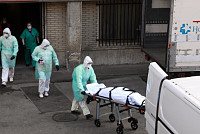 Spain passes 10,000 deaths after its...