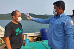 Four Taiwanese fishermen detained for...
