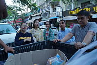 A group of youths donate food,...