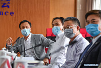 Chinese medical experts arrive in...