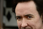 John Cusack Pushes for Removal of...