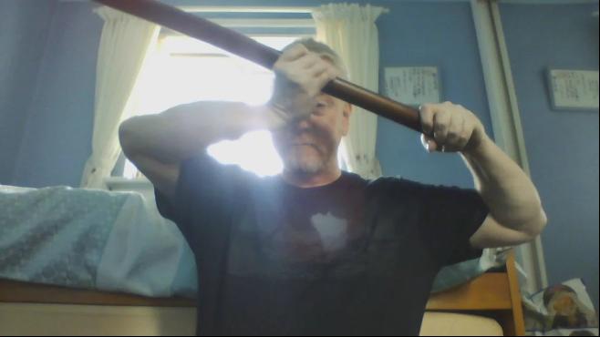 A man demonstrates a sword technique