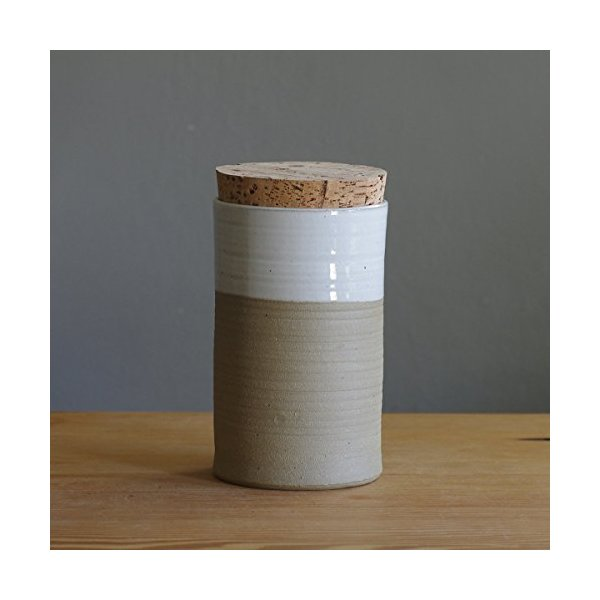 white and sand colored stoneware pottery jar