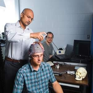 Dr. Sunderam with volunteer Dillon Huffman recording brain signals