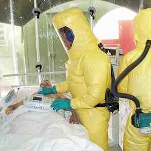 Patient in isolation with Ebola virus being cared for by nurses in protective gear