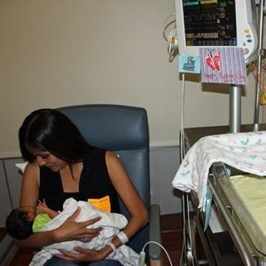 Melissa Renteria holds her newborn baby, Arthur, while he's monitored by the HeRO technology (credit: University of San Diego Health)
