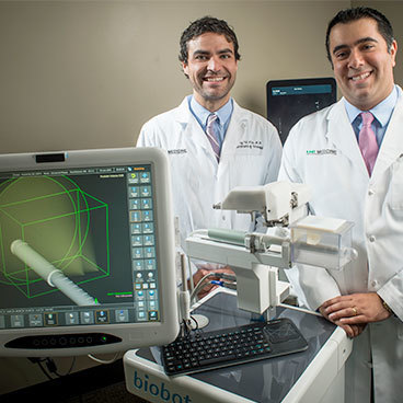 Jeffrey Nix, M.D., left, and Soroush Rais-Bahrami, M.D., with the iSR'obot Mona Lisa, a new image-guided device for diagnosing prostate cancer prostate cancer