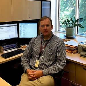 Christopher Moore, MD, of the University of Virginia School of Medicine, is part of an international team of researchers that has developed a new tool to help healthcare providers ID patients at the greatest risk when resources are most limited.