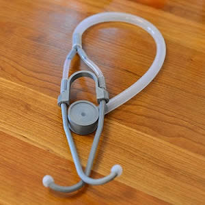 The stethoscope is built using 3-D printed parts, and recycled plastic tubing.