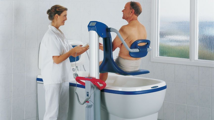 Electrical medical bathtub / with lift seat / height-adjustable Century ArjoHuntleigh