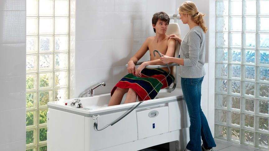 Electrical medical bathtub / with lift seat / height-adjustable Sovereign™ ArjoHuntleigh
