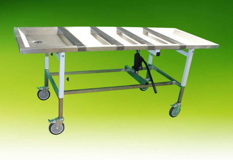 Height-adjustable embalming table / on casters / hydraulic A.R. Twigg & Son