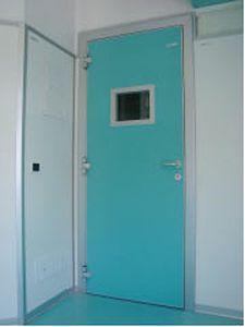 Swinging door / radiation shielding / hardwood / with glass panel Cablas