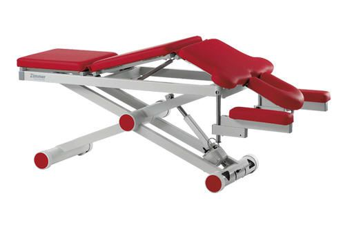Electrical massage table / height-adjustable / on casters / 3 sections aXion Zimmer MedizinSysteme