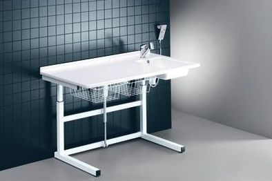 Changing table / electric / with sink / height-adjustable R8752 Pressalit Care